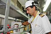 Kitchen of the 'Y M Orchid', a Chinese ship. Lieutenant Paolo Leone checks whether food hygiene standards are respected. Port of Genoa.