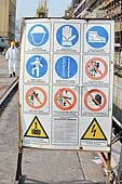 Sign indicating the safety regulations to respect. Ship construction site. Port of Genoa.