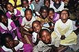 Many children whose parents died of HIV/AIDS visit this primary school of the Kiwohede (Kiota Women