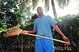 A young employee of the Dar Es Salaam municipality cleans the streets. Dar Es Salaam