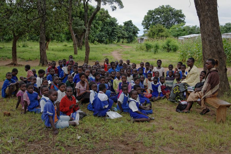 Many schools simply don't have the classrooms and teachers to handle the increased enrollment. There are no chairs or desks for these children so they attend classes under a tree. When it rains, the children have to go back home, where they are at risk once again of falling back into child labour.